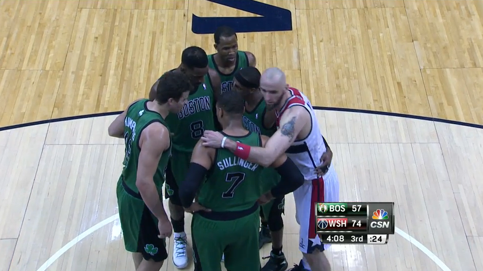 Marcin Gortat sneaks into the Boston Celtics' huddle