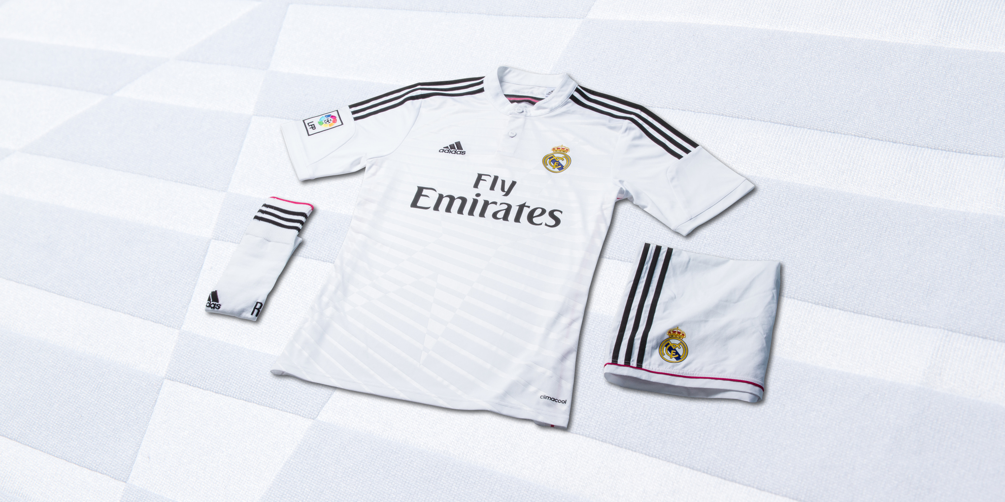 b737a2b3b The 2014 15 home shirt comes in Madrid s traditional white color and  features a stunning rugby collar that ties the club to a number of adidas   other ...