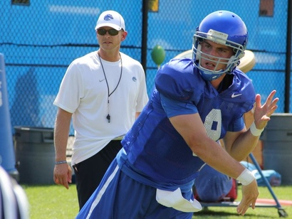 1407127467012-8-3-grant-hedrick-fires-a-pass-with-bryan-harsin-looking-over-his-shoulder_jpg