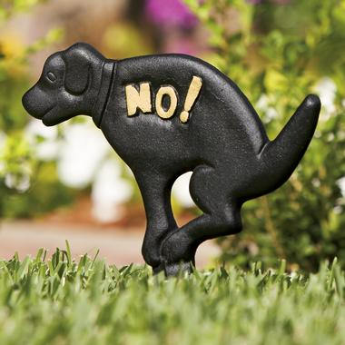 Doggy Don't sign, depicting a squatting dog with the word NO written on it.