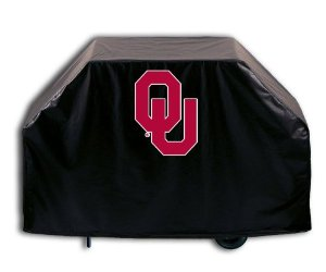 Grill covered with black cover bearing the Oklahoma Sooners O.U. logo