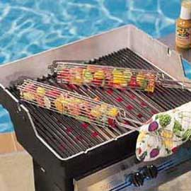 Two kabob baskets filled with chopped meat and vegetables, cooking on a grill