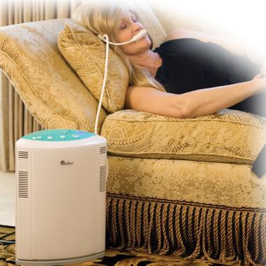 Woman lying on a coach with the mouthpiece of the Tranquil Sounds Oxygen Bar in her mouth