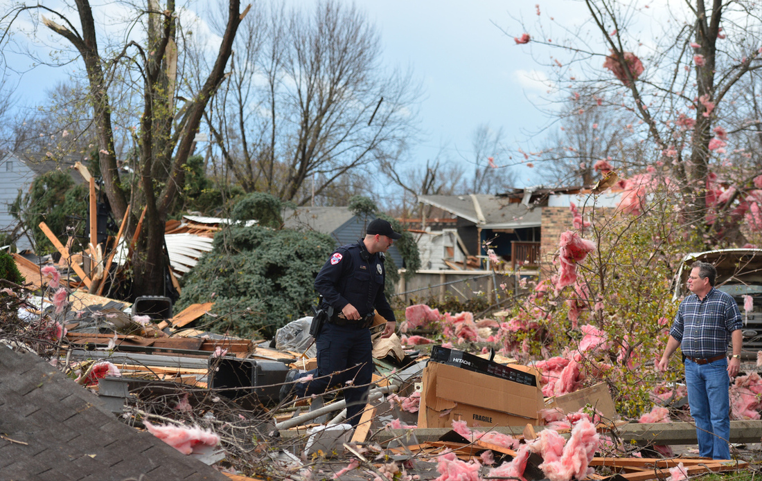 Police officers try to sort through the damage in Pekin, Ill. (AP Photo/Journal Star, Fred Zwicky)