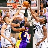 Millsap_and_kirilenko_stuffing_kobe