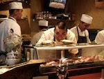 Kata-Robata-Sushi--Grill-Chef-Manabu-Horiuchi-cheking-out-live-scallops-before-preparing_171728.jpg