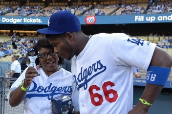 Puig's Mom Tosses First Pitch on His Bobblehead Night