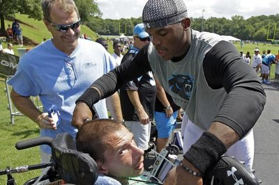 Cam Newton gives special gift to fan in a wheelchair