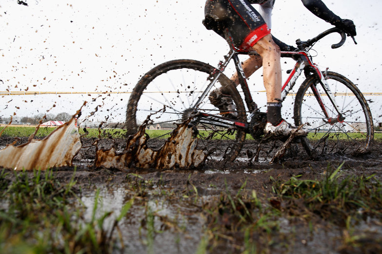 Photo: Deep mud. It's fun to flop around in. It's fun to see guys covered in it.