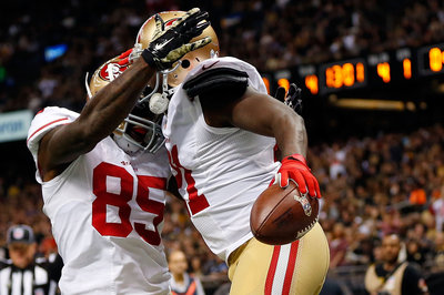 Vernon Davis gets tackled running a route vs. Saints
