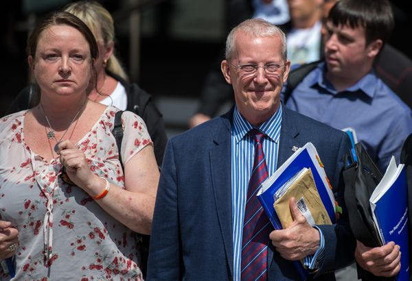 Sir John Chilcot next to Sarah O'Connor, whose brother was killed in Iraq.