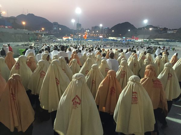 Prospective pilgrims walk to stone the devil as part of the annual Islamic Hajj pilgrimage at Jamarat during the first day of Eid Al Adha in Mecca