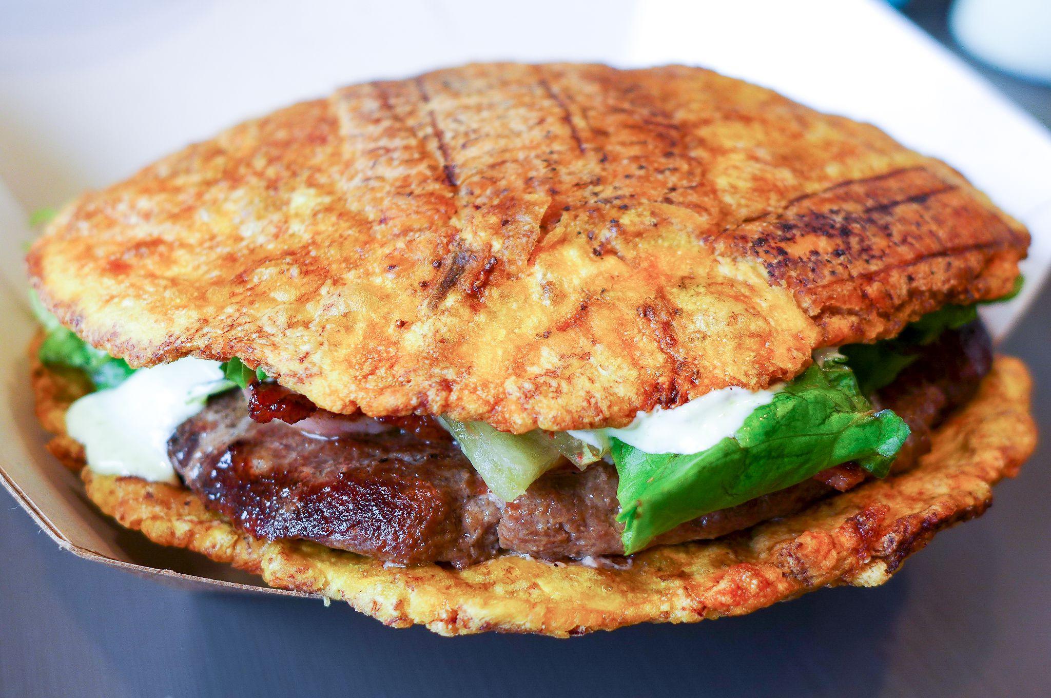 ... balkan pljeskavica the venezuelan patacon burger easily fills its