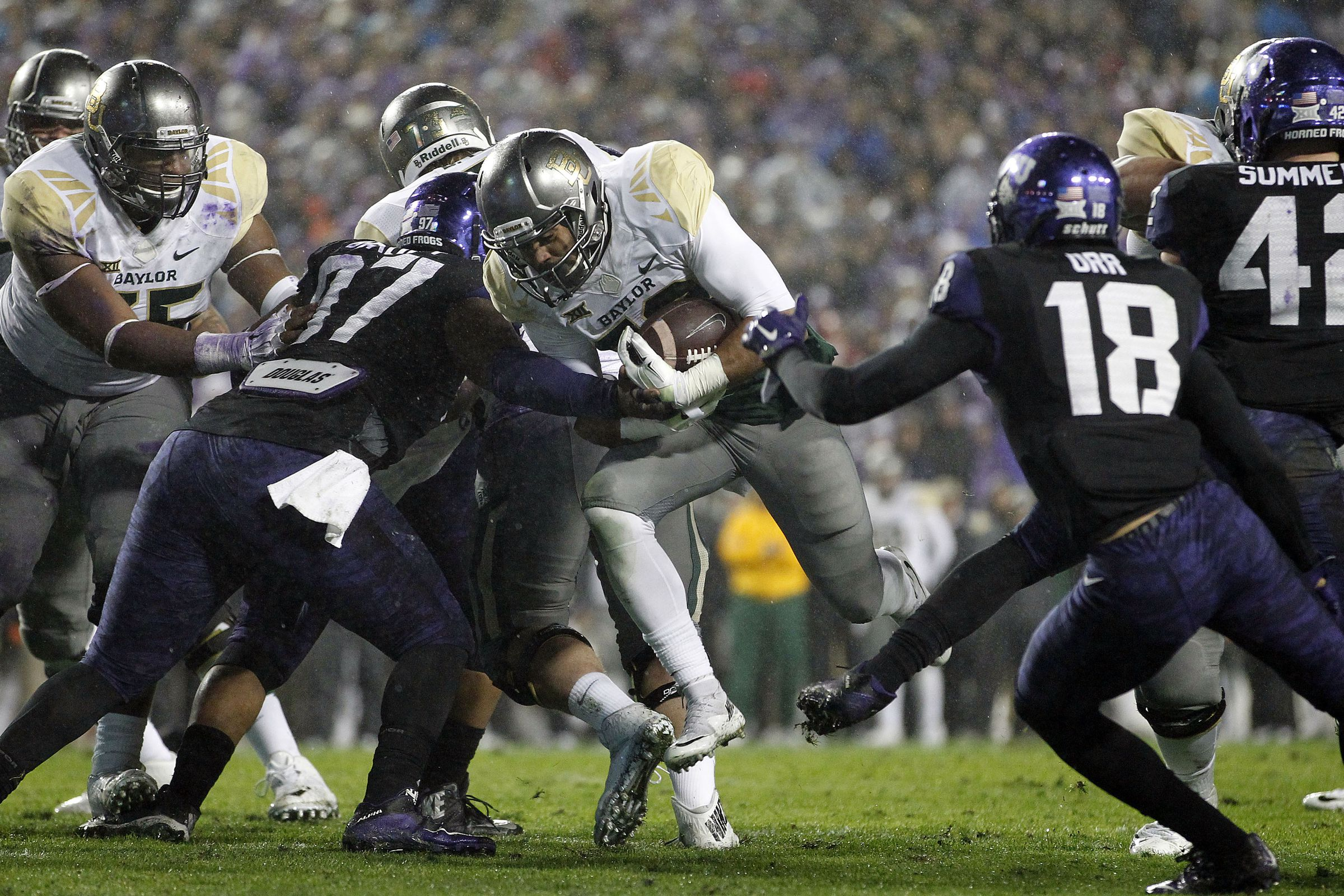 TCU rallies past Baylor in the rain and in OT, 28-21