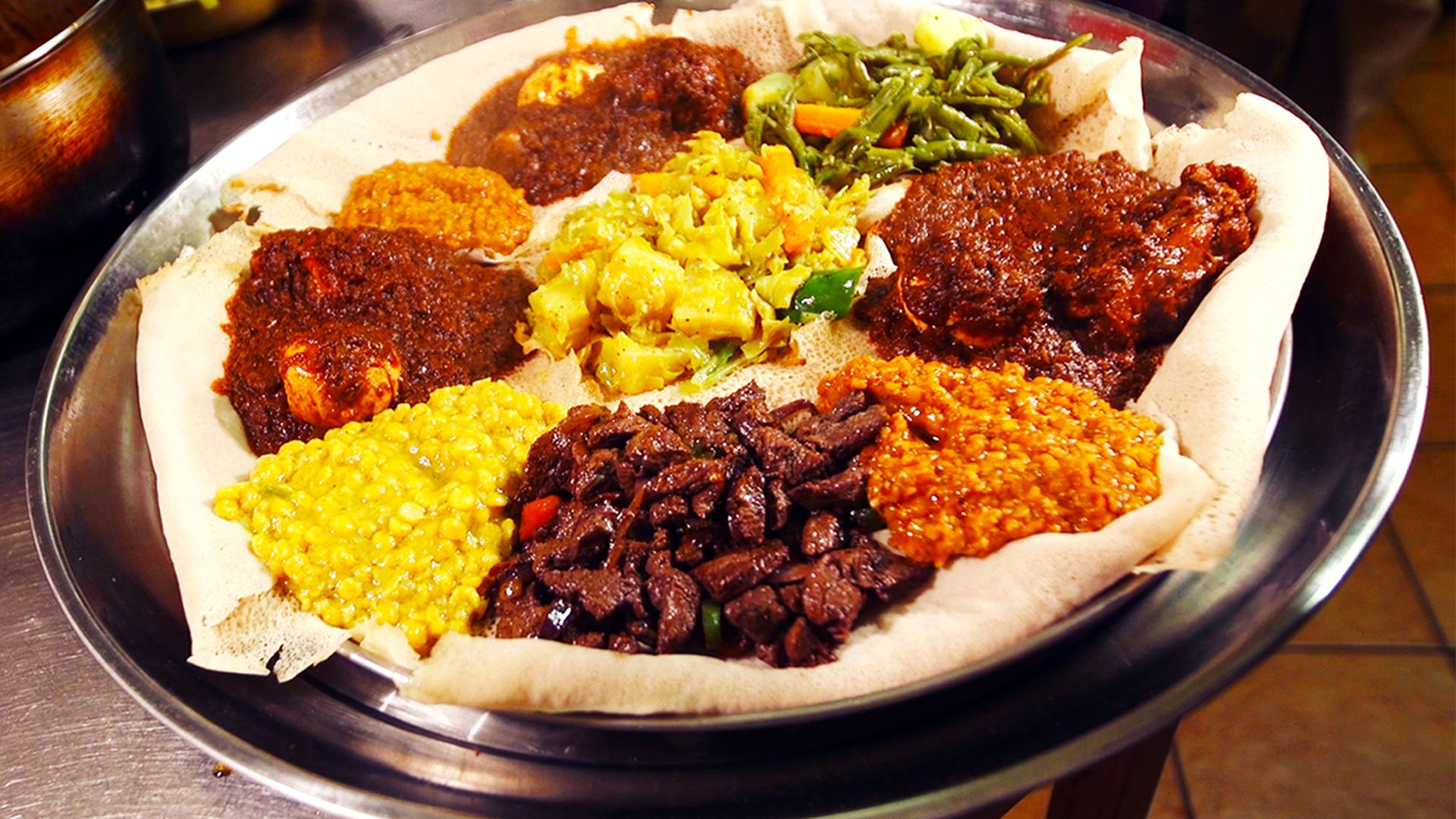 Watch: Earthy Chicken Stew and Soft, Spongy Injera at Rome's Best