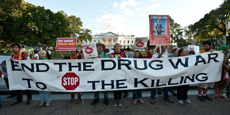 Protesters in front of the White House call for an end to the war on drugs.
