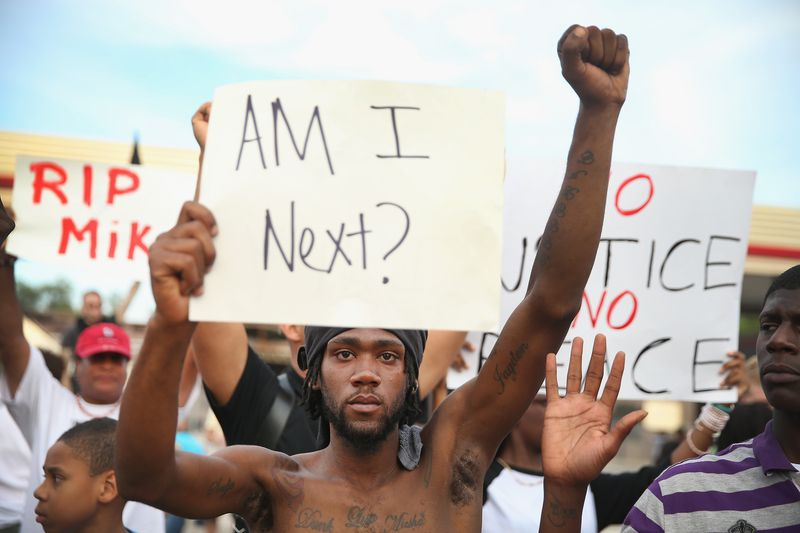 A man protests the police shooting of Michael Brown in Ferguson, Missouri.