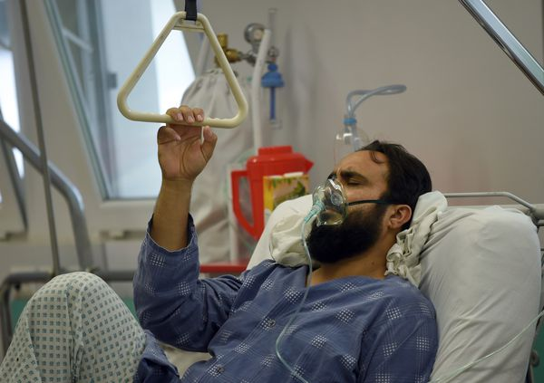 A wounder MSF staffer in a hospital in Kabul