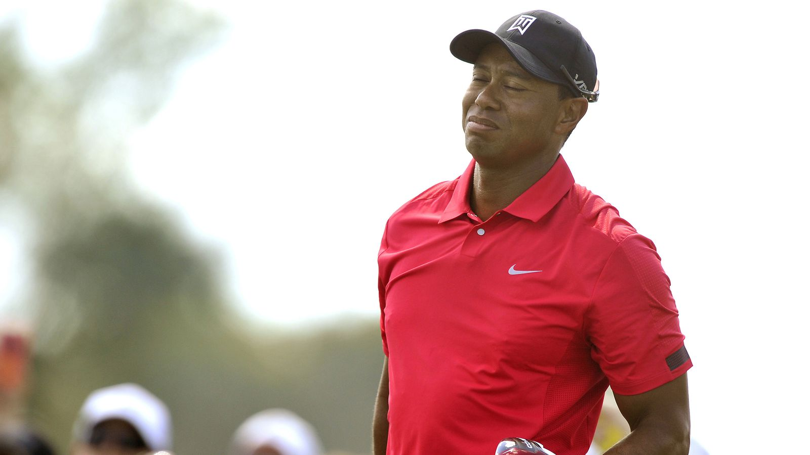 tiger woods withdraws from honda classic with bad back