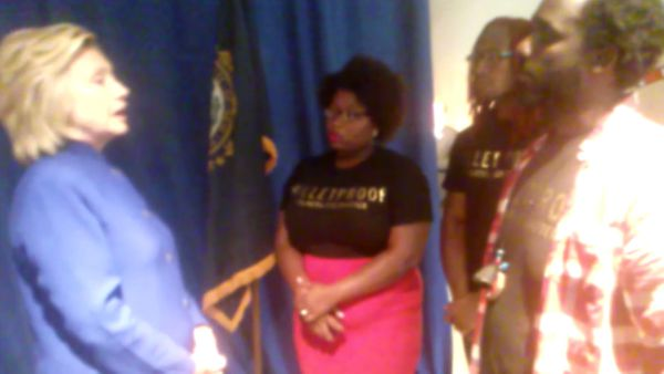 Hillary Clinton (left) with Black Lives Matter activists