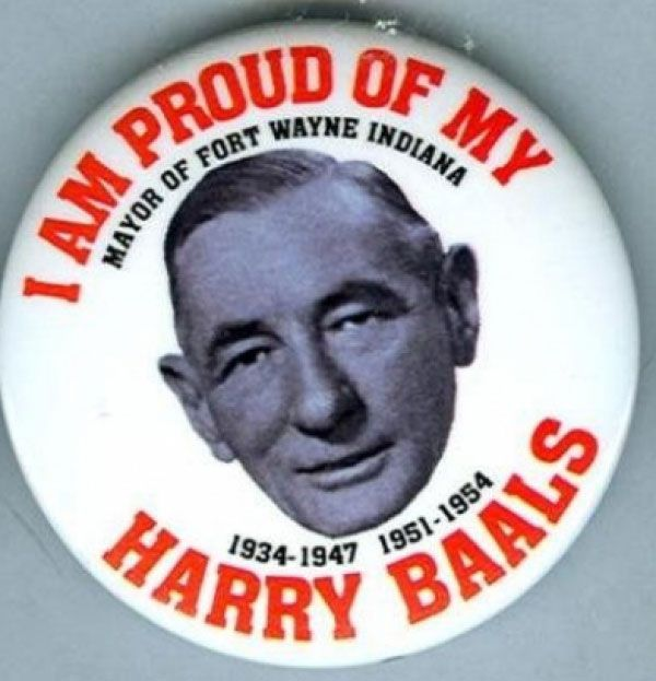 "Picture of Harry Baals' face on a political voter button which reads, ""I am proud of my Harry Baals"" in red varsity-style font"