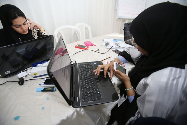 Volunteers phone-bank for a female candidate in the Saudi municipal elections in Jeddah.