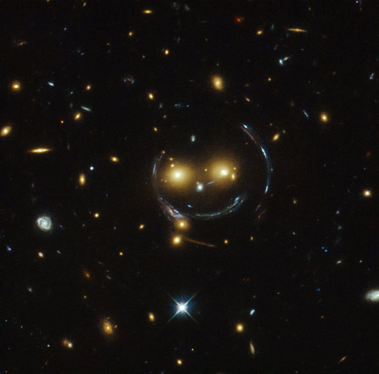 The Hubble telescope found a smiley face in space. The science behind it is even cooler.