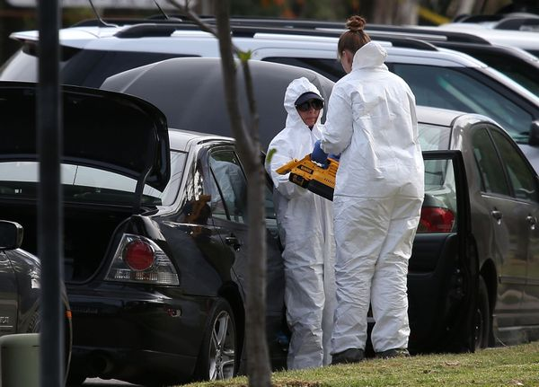 FBI personnel investigate a car allegedly belonging to Syed Farook.