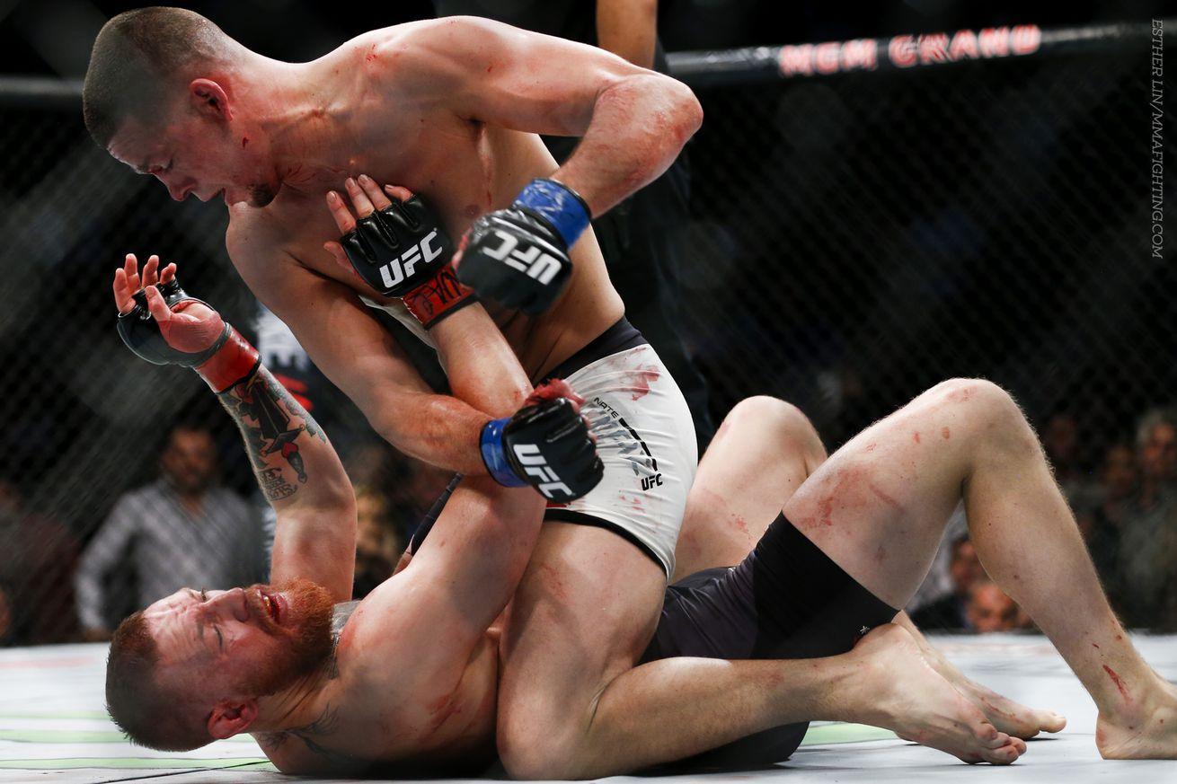 https://cdn2.vox-cdn.com/thumbor/lTk83srnmOxijop0gYUT1u9vB3A=/0x0:1920x1280/1310x873/cdn0.vox-cdn.com/uploads/chorus_image/image/49057745/159_Conor_McGregor_vs_Nate_Diaz.0.0.jpg