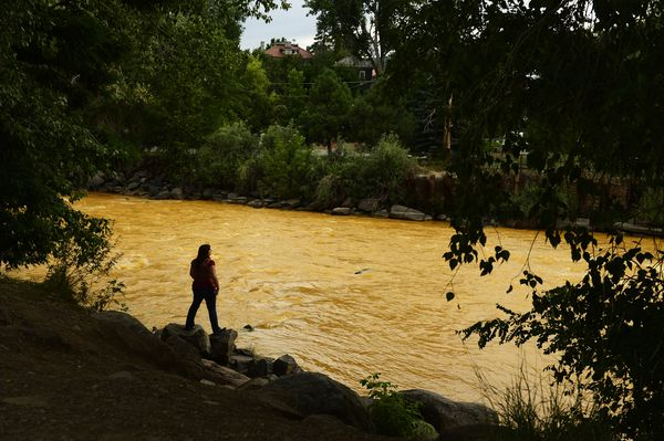 Kalyn Green looks out over the yellow, polluted Aminas River in Durango, CO.