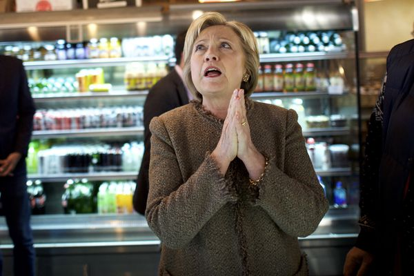 Hillary Clinton reacts to menu options while visiting Saffron Cafe & Bakery in Charleston, South Carolina.
