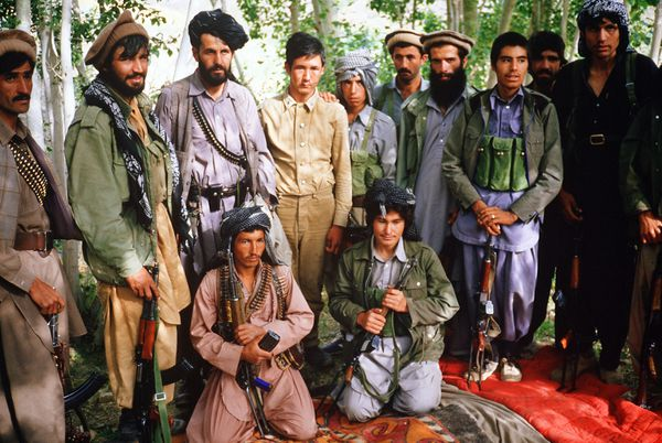 Mujahideen anti-Soviet fighters in Afghanistan in 1986, with Soviet POW center (PATRICK DAVID/AFP/Getty)