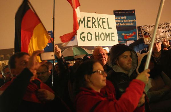 Supporters of the German conservative party Alternative for Germany (German acronym: AfD) protest Angela Merkel's policies toward refugees.