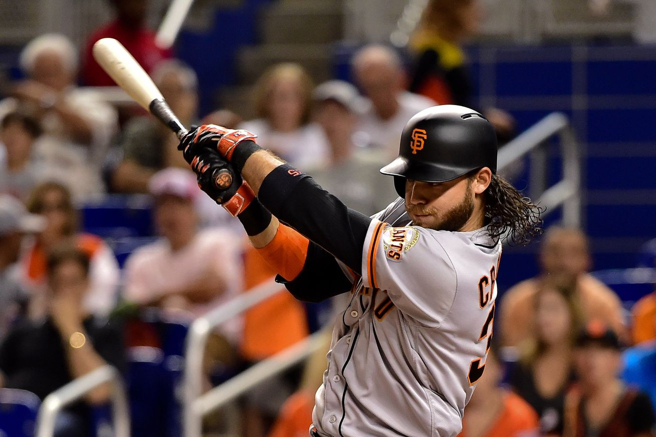 Crawford 1st with 7 hits since '75, Giants win in 14 innings