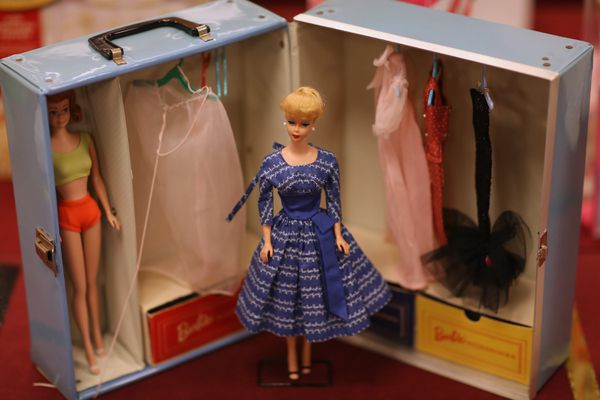 A vintage Barbie is raffled off at the 2015 National Barbie Doll Collectors Convention in Arlington, Virginia, on July 31.
