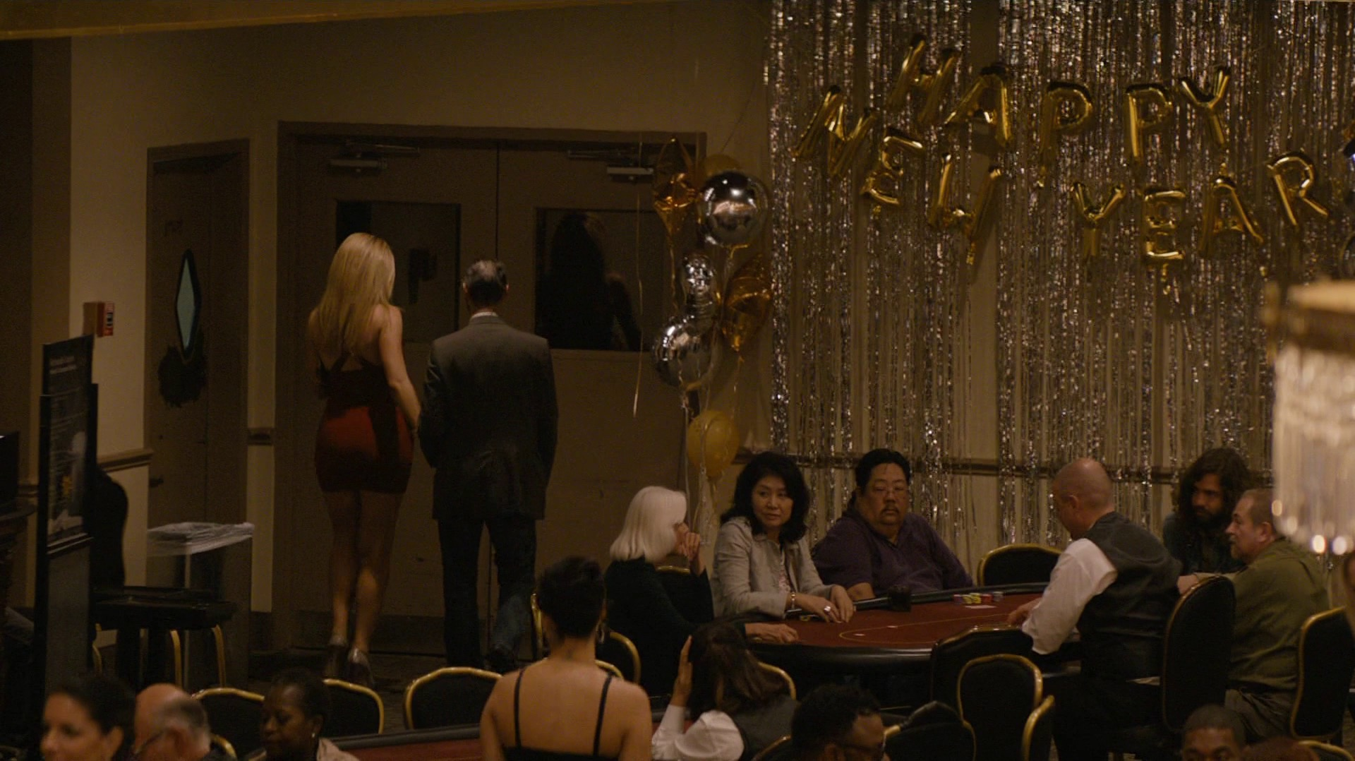 A man and a prostitute in Frank's poker room