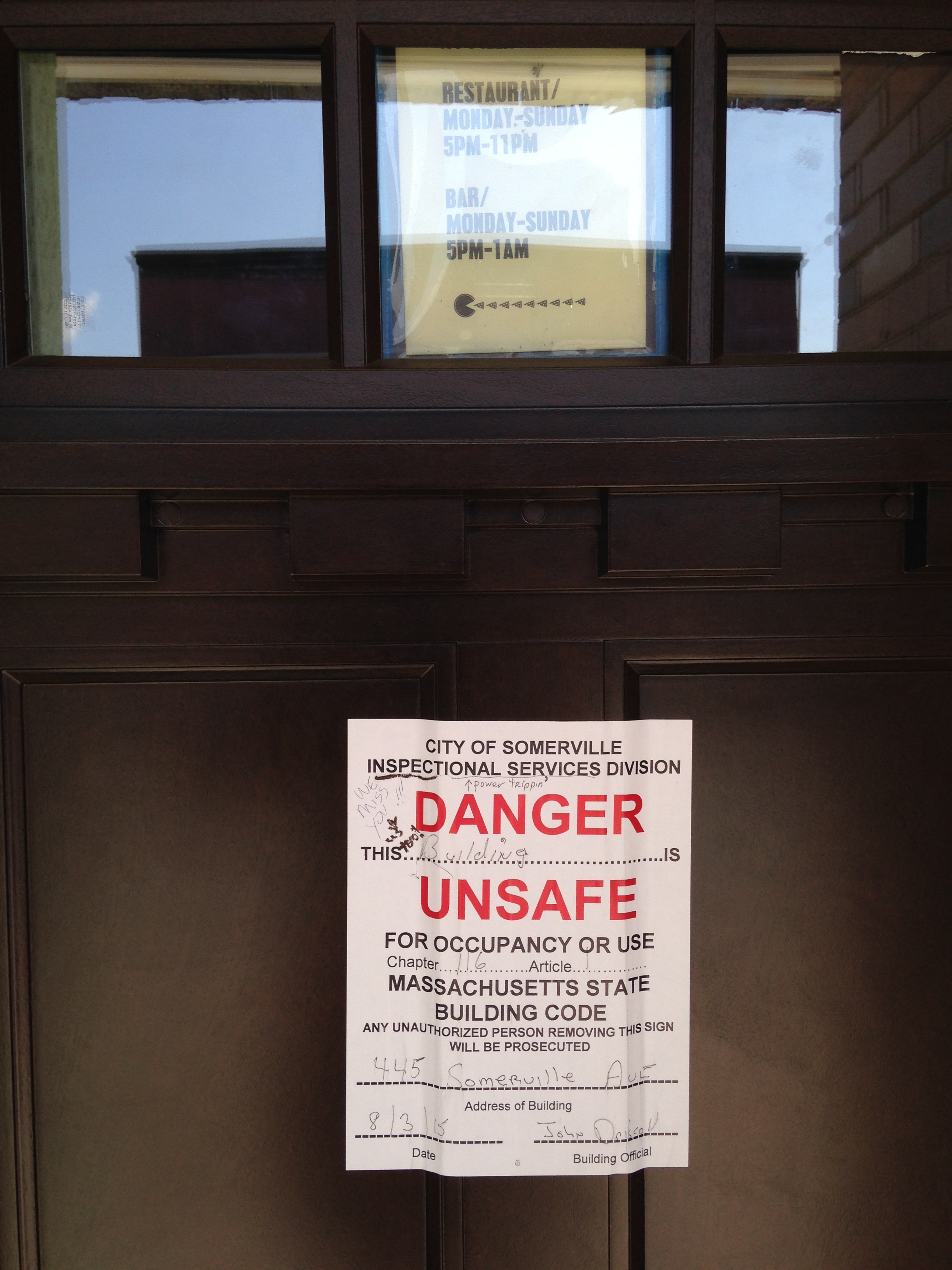A4 Pizza building unsafe sign