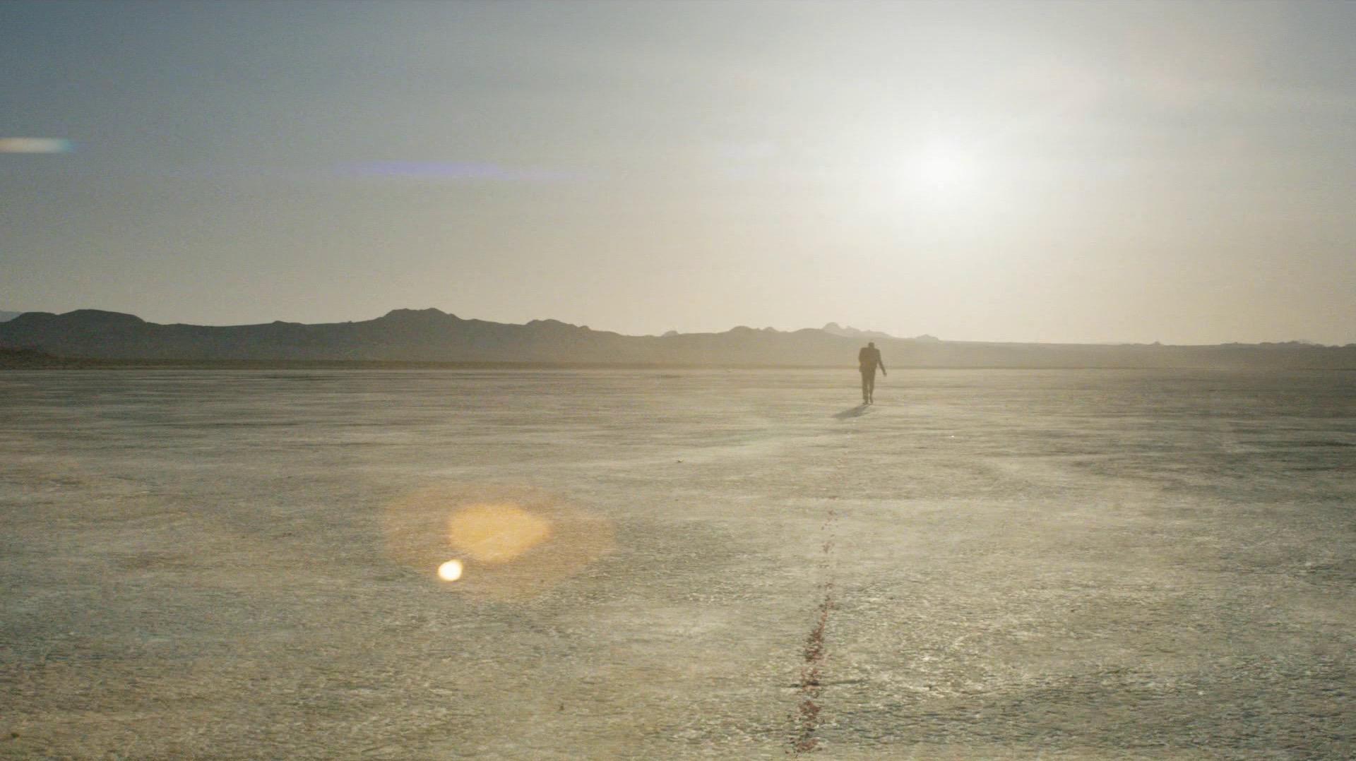 Frank walks through the desert
