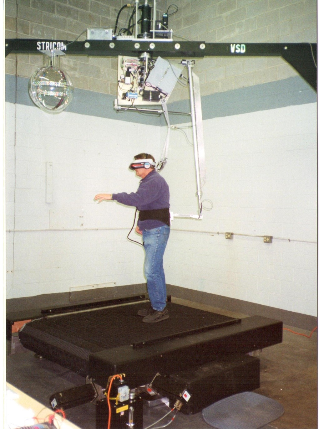 An early omnidirectional treadmill, used for walking in virtual reality