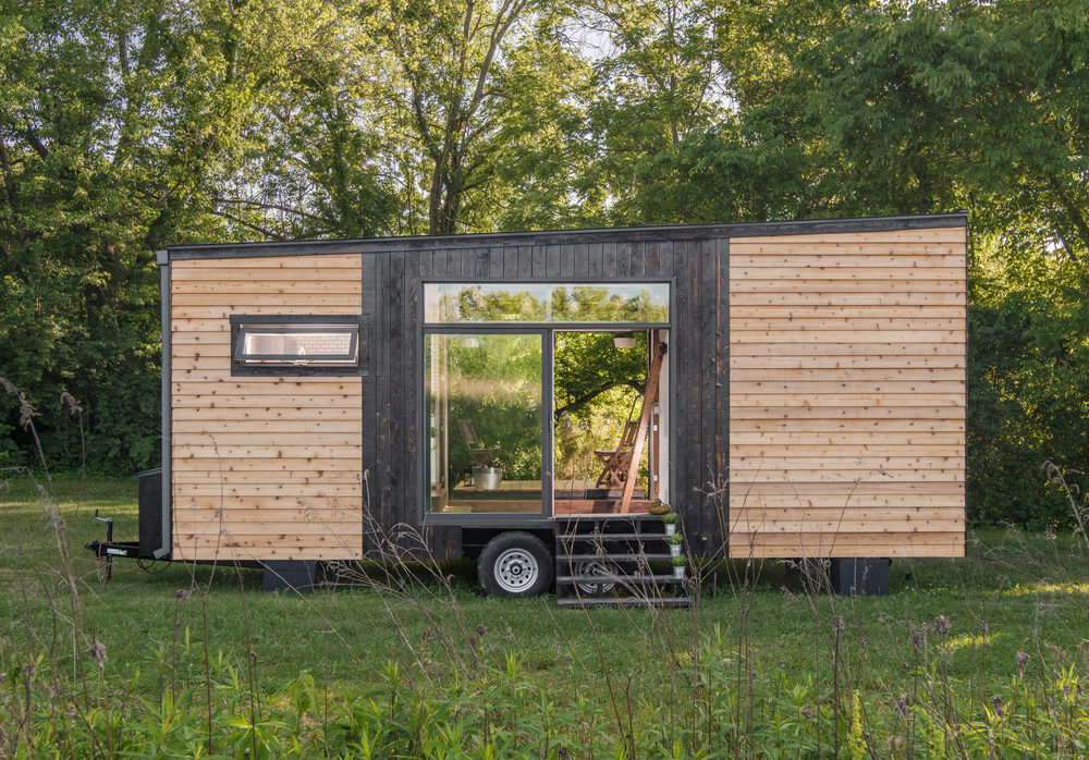 Tricked Out Tiny Home Features Garage Door and Custom Deck Curbed