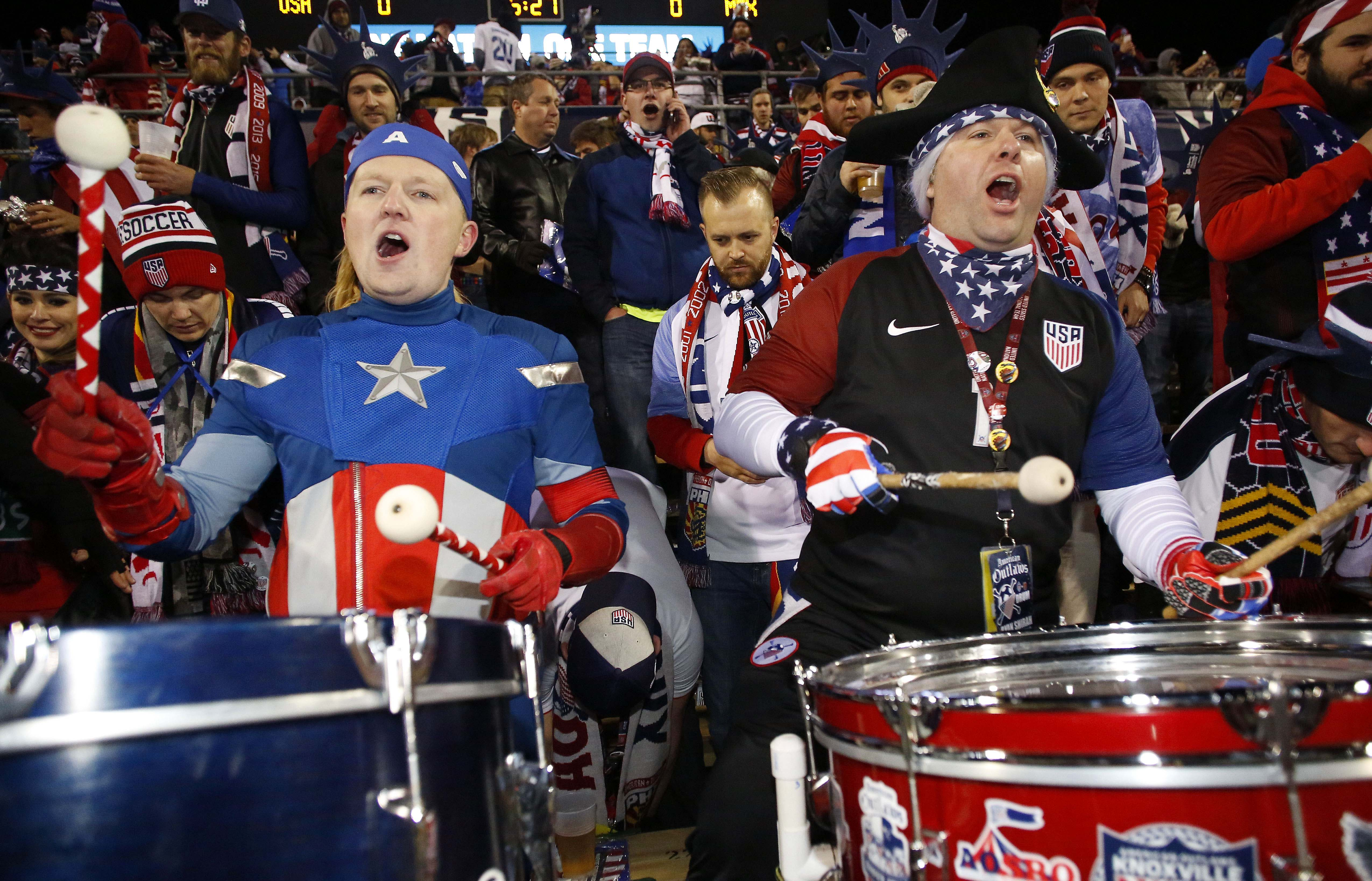 USA fans prior to the Team USA against Mexico match at MAPFRE Stadium, dressed as Captain America and a colonial patriot, both beat drums.