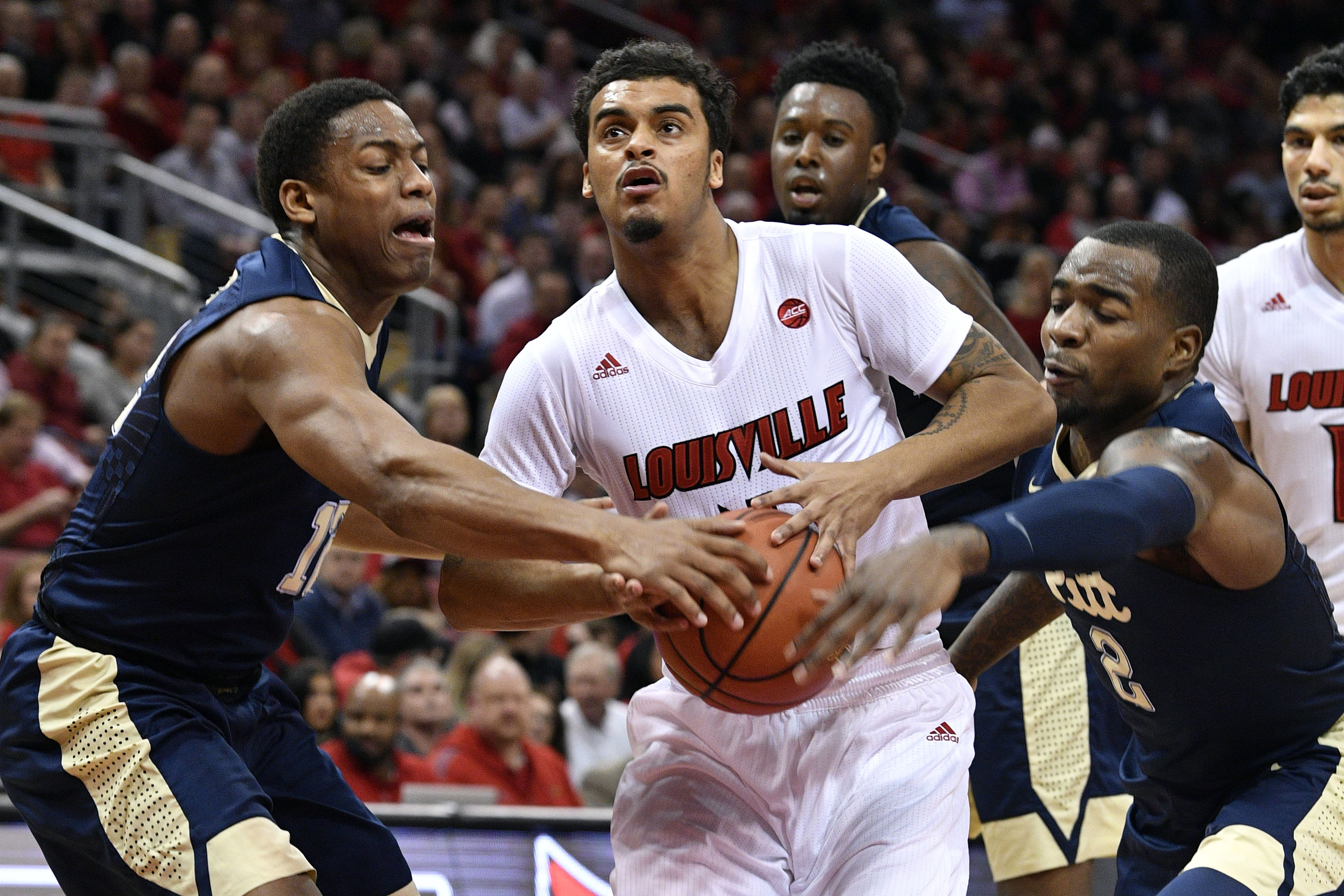 No. 8 Louisville outlasts Syracuse in overtime, 76-72
