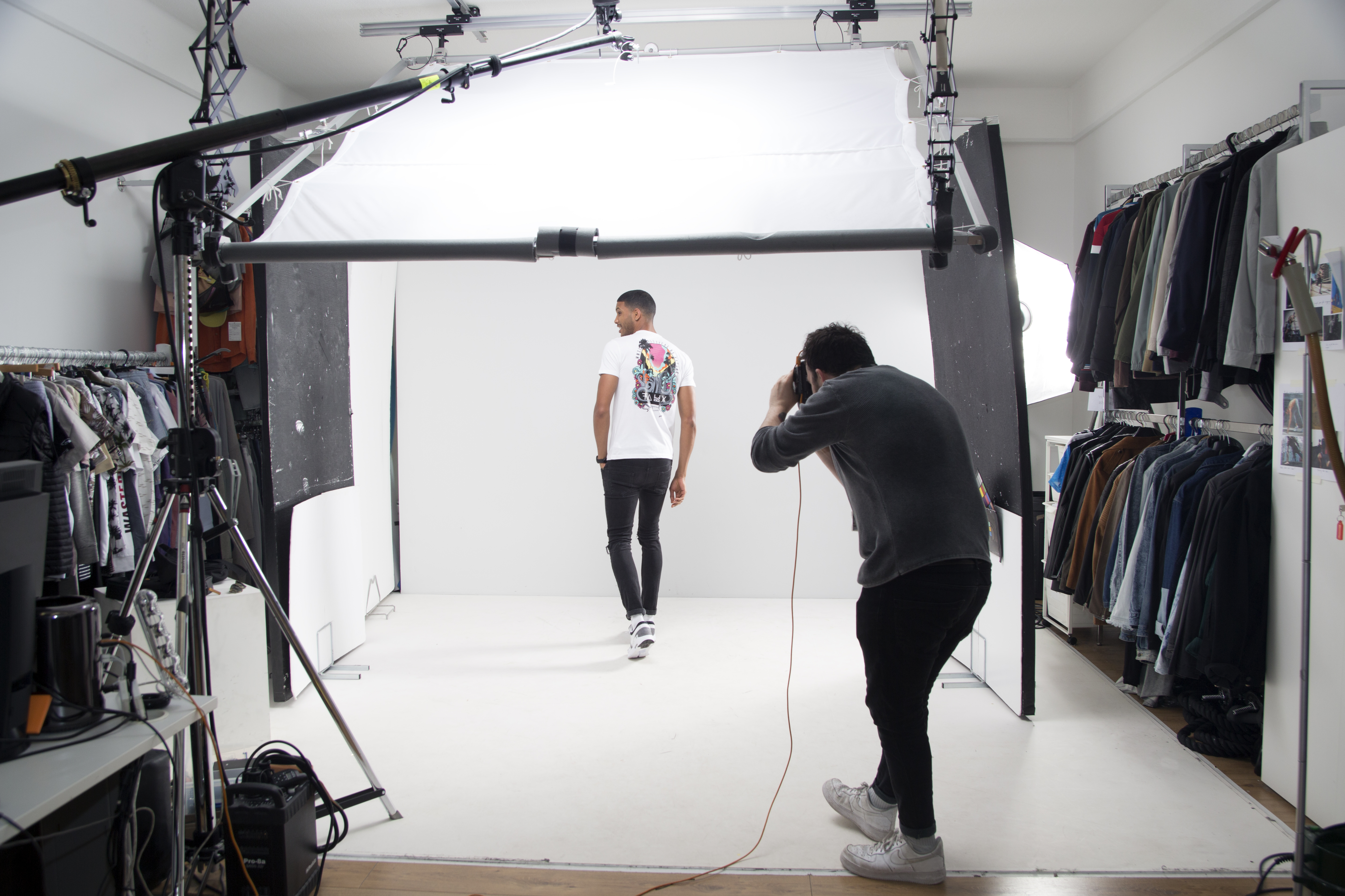 A photographer shoots a model in a studio at ASOS headquarters.