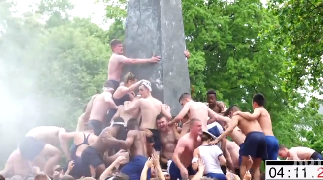 Naval Academy students climb Herndon Monument